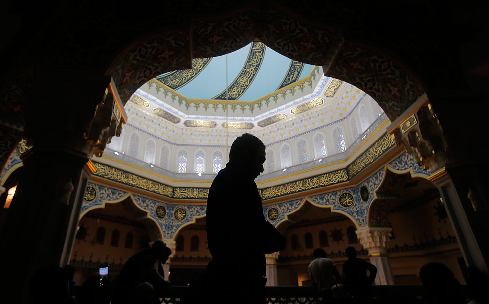 Muslims pray during Friday prayer service at Moscow's grand mosque in Rissia