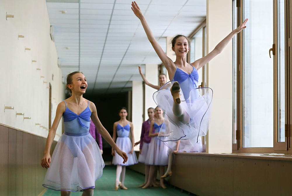 Students dance in the hallway during a break at Moscow State Academy of Choreography in Moscow, Russia. Moscow State Academy of Choreography is the oldest institution in Moscow which teaches Ballet arts not only Russian citizens, but also representatives from more than 20 countries.