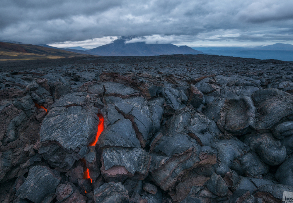 Volcanic lava cooling down in the cracks of the ground at the Tolbachik volcano complex, Kamchatka Peninsula.