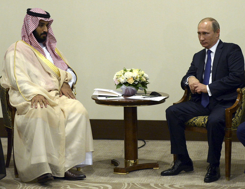 Russian President Vladimir Putin (R) meets with Saudi Defence Minister Mohammed bin Salman in Sochi, Russia