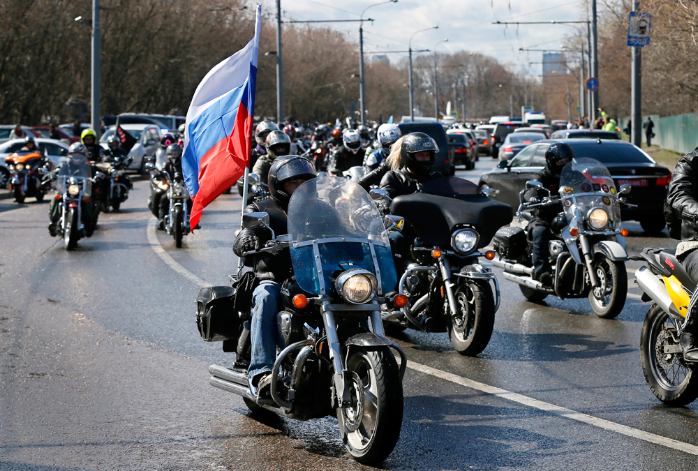 Russian bikers attend a motocross in honor of the 70th anniversary of the Victory over Nazi Germany in the World War II, in Moscow, Russia, April 25, 2015.