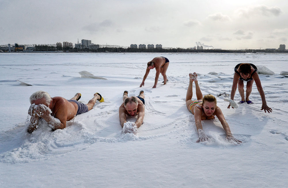 "Russia. Blagoveshchensk. March 14, 2016. Residents of the city in the Russian bath ""Zastava"". Chairman of the Health Club ""Amur walruses"" Alex Balandin hole arranged for winter swimming and sauna on the shore of the Amur, where the state border of the Russian Federation and China."