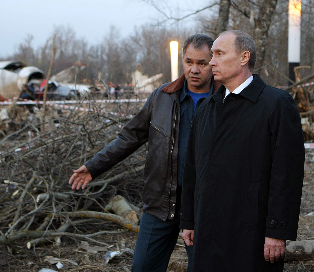 Russian Prime Minister Vladimir Putin, right, and Emergency Situations Minister Sergei Shoigu inspecting the Polish Air Force Tu-154 plane crash site near the Severny airport outside Smolensk on April 10, 2010.
