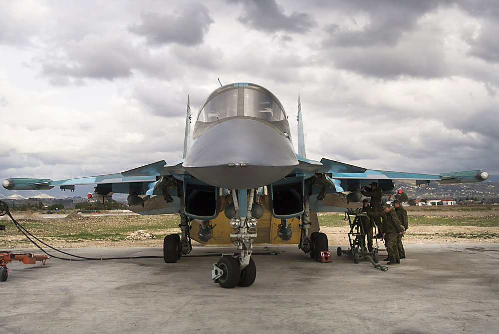 Russian air force crew prepare a Su-34 bomber for a combat mission at Hemeimeem air base in Syria.