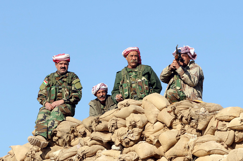Members of the Kurdish peshmerga forces gather in the town of Sinjar, Iraq, Nov. 13, 2015.