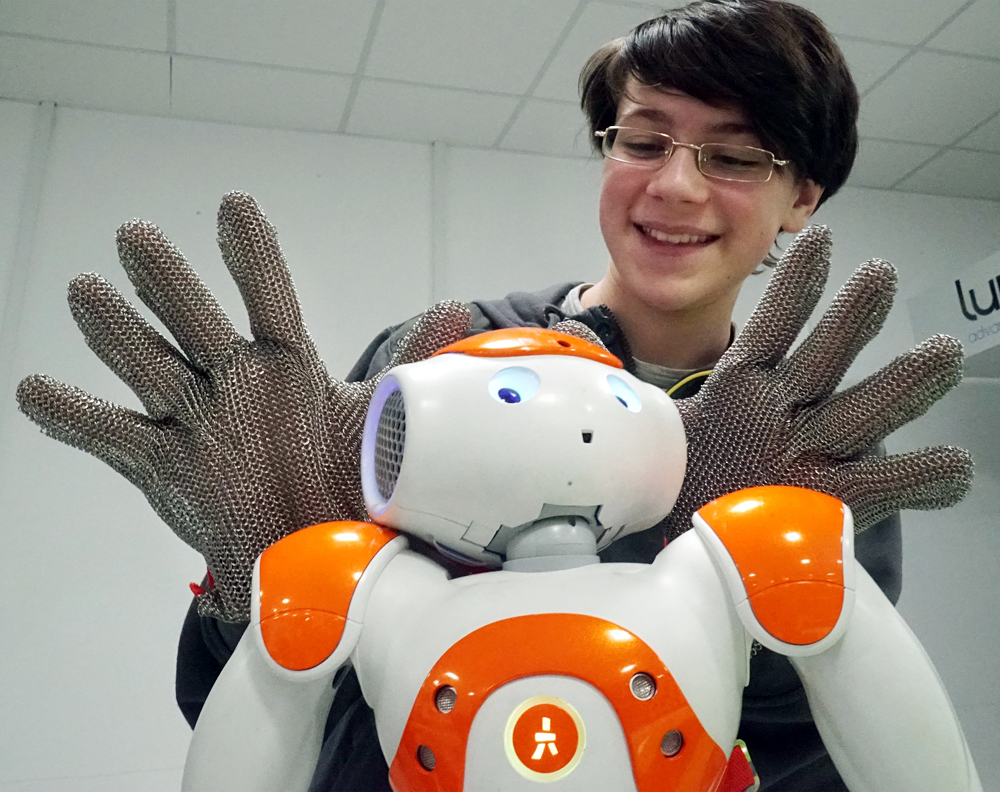 A schoolchild is seen here with a NAO robot at the IT sector of the 'Fablab' industrial laboratory of the Fabrika techno park at the Immanuel Kant Baltic Federal University, Kaliningrad.