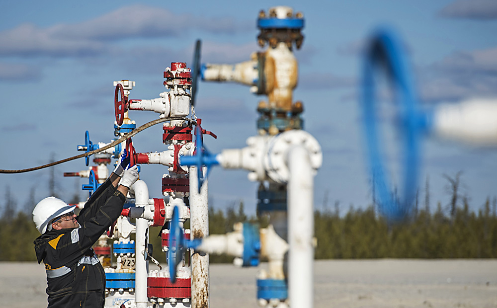 Associate of the RN-Purneftegaz Company, a subsidiary of the Rosneft Oil Company, seen on the Barsukovsky field, Yamal-Nenets Autonomous District.