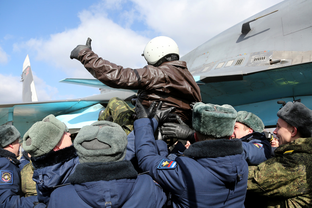 A Russian pilot receives a hero's welcome on returning from Syria at an airbase near the Russian city of Voronezh, March 15, 2016.