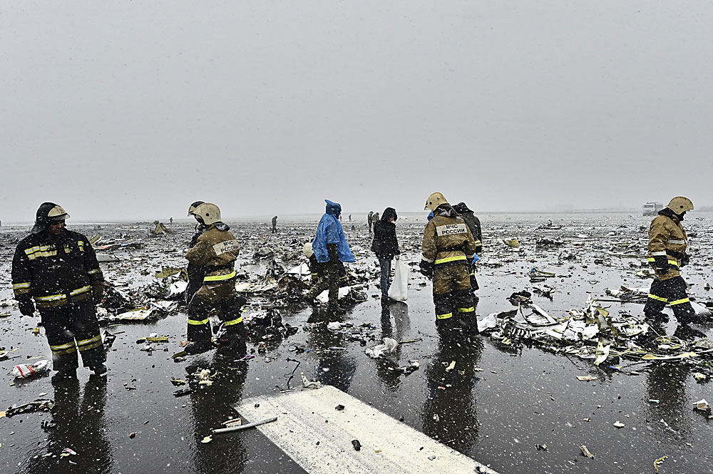 Russian Emergency Ministry employees among the wreckage of a crashed plane at the Rostov-on-Don airport, about 950 kilometers (600 miles) south of Moscow.