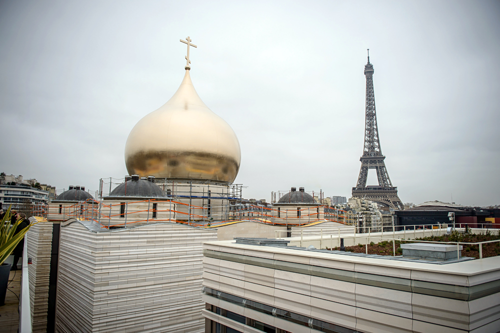 A view showing the Eiffel tower during a ceremony for the installation of a golden dome on the Russian Orthodox Church being built in Paris, France