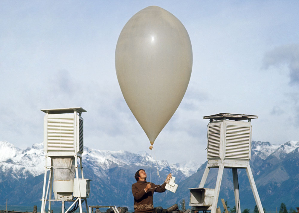 An employee checks the weather balloon at the upper-air synoptic station in the town of Chara, Eastern Siberia.