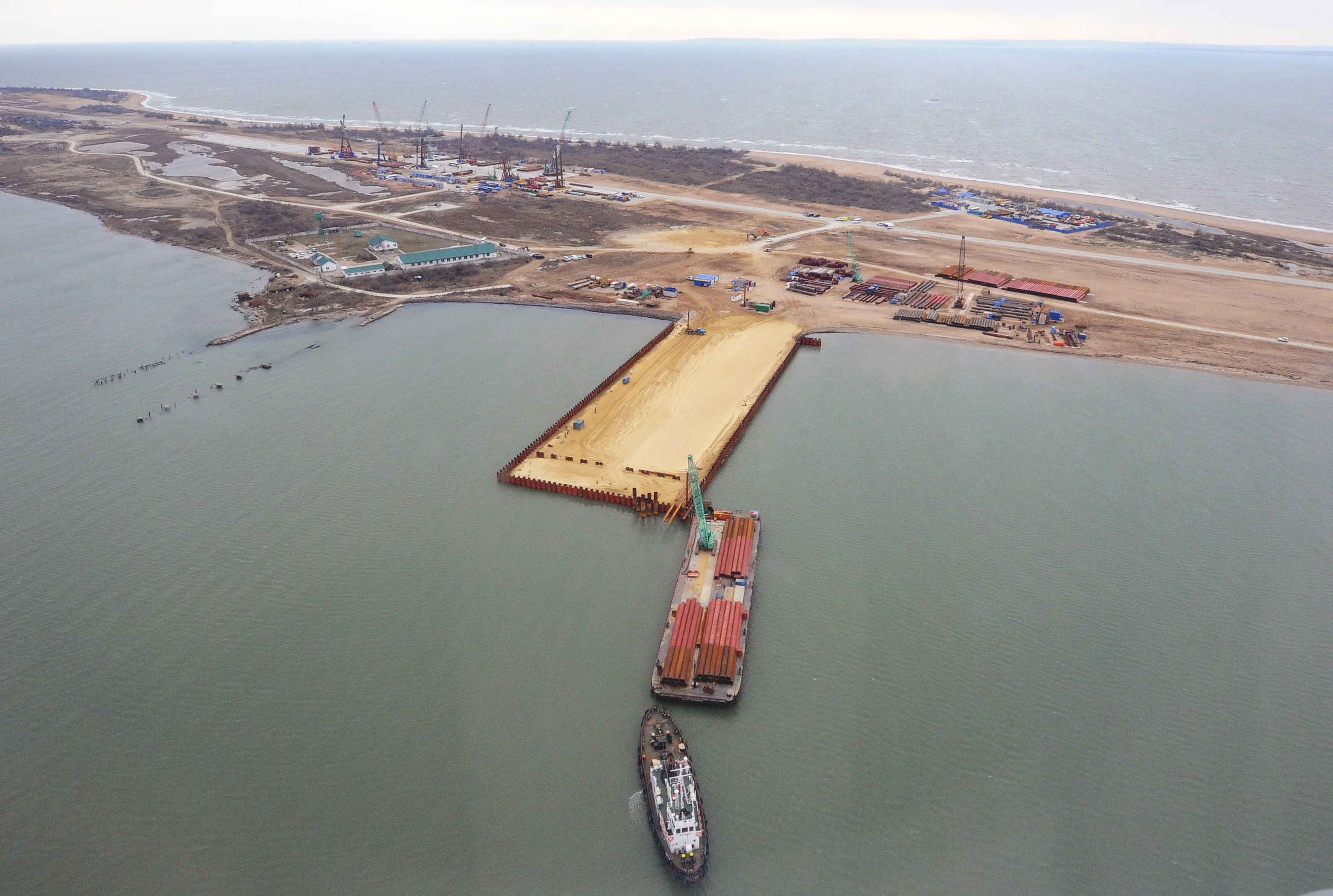 An aerial view of the construction site of a bridge across the Kerch Strait.