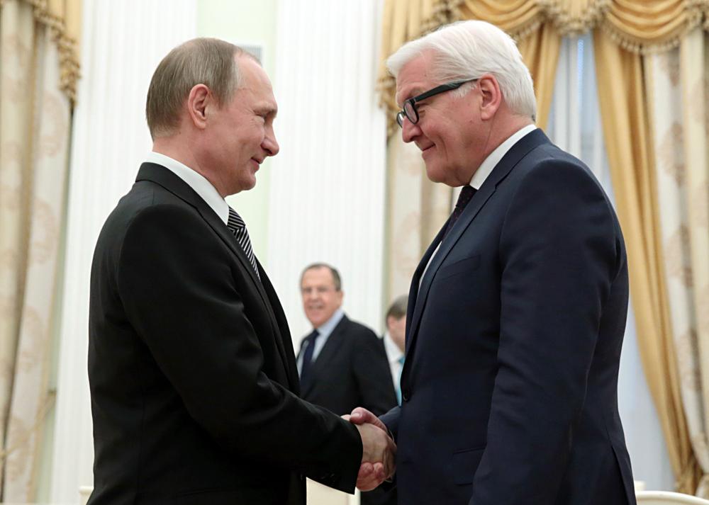 Russian President Vladimir Putin and German Foreign Minister Frank-Walter Steinmeier.