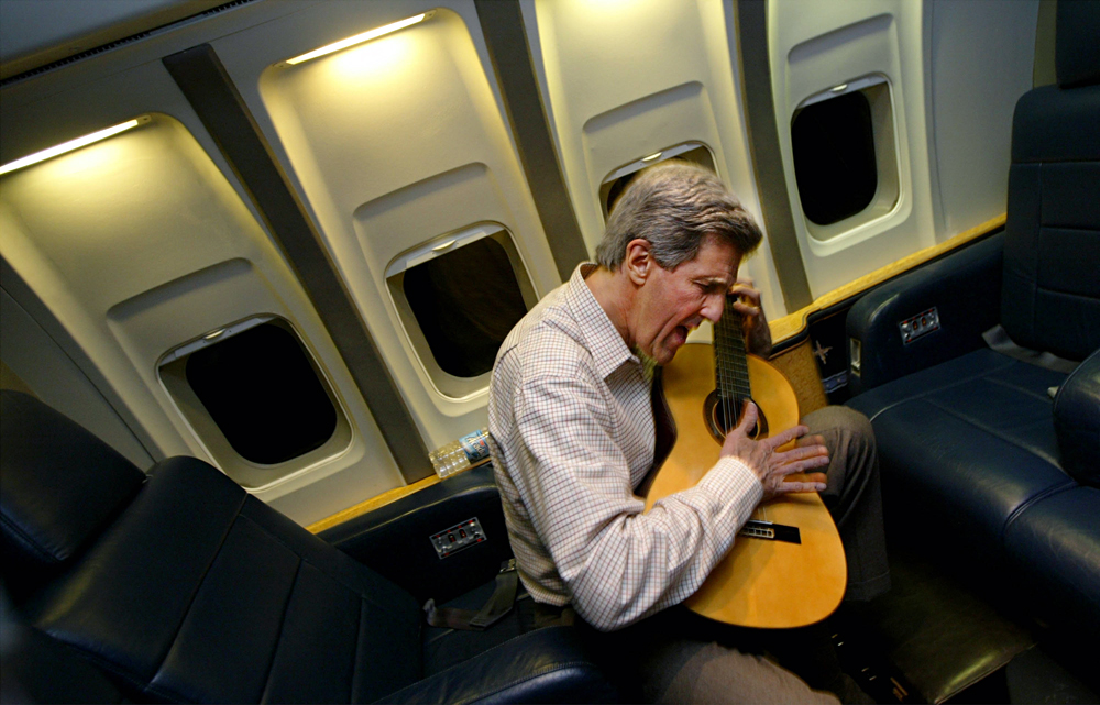 John Kerry plays his guitar.