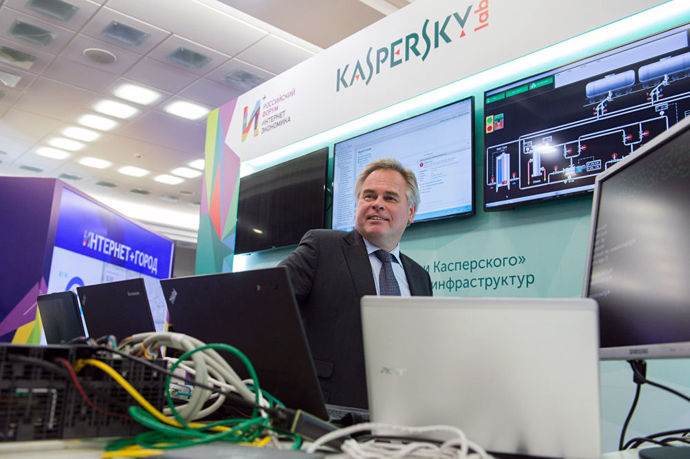 Head of Kaspersky Lab Yevgeny Kaspersky near the Lab's stand during the exhibition of Russia's first Internet Economy Forum, Dec.22, 2015.