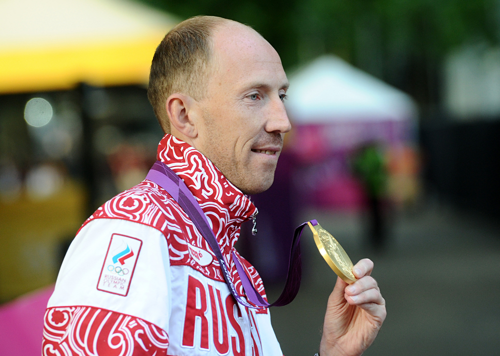 Russia's Sergey Kirdyapkin shows off his gold medal for the Men's 50km race walk at the London 2012 Olympic Games.