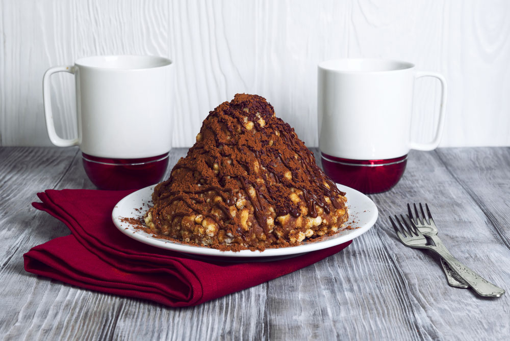 Muraveynik topped with cocoa powder looks like a real anthill.