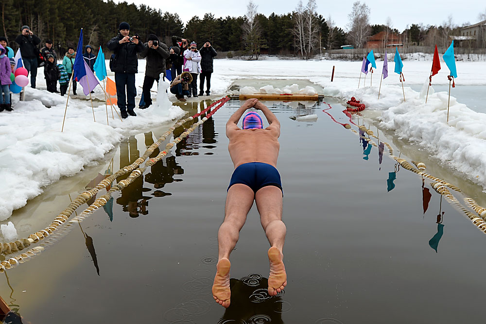 Participant in the 2nd Annual Inter-regional Ice Swimming Tournament held in remembrance of Merited Construction Worker of Russia and honorary citizen of Berdsk Vladimir Stakheyev at the Blue Lake base in Berdsk.