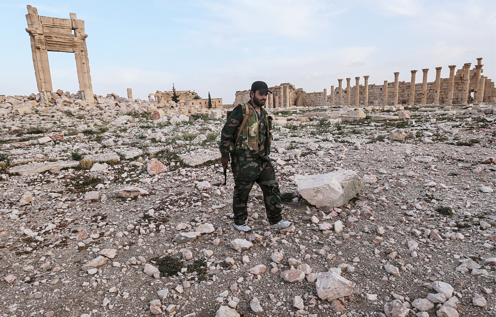 A Syrian government army soldier on ruins of the temple of Bel destroyed by ISIS militants in Palmyra, a UNESCO world heritage site.