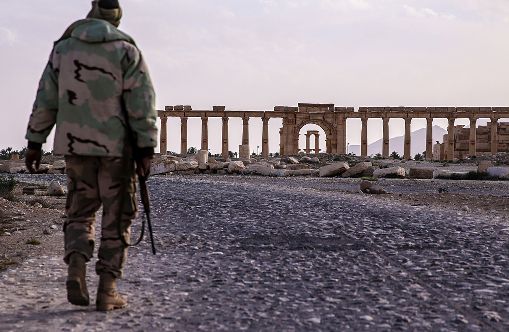 A Syrian government army soldier near the Great Colonnade in Palmyra, a UNESCO world heritage site.