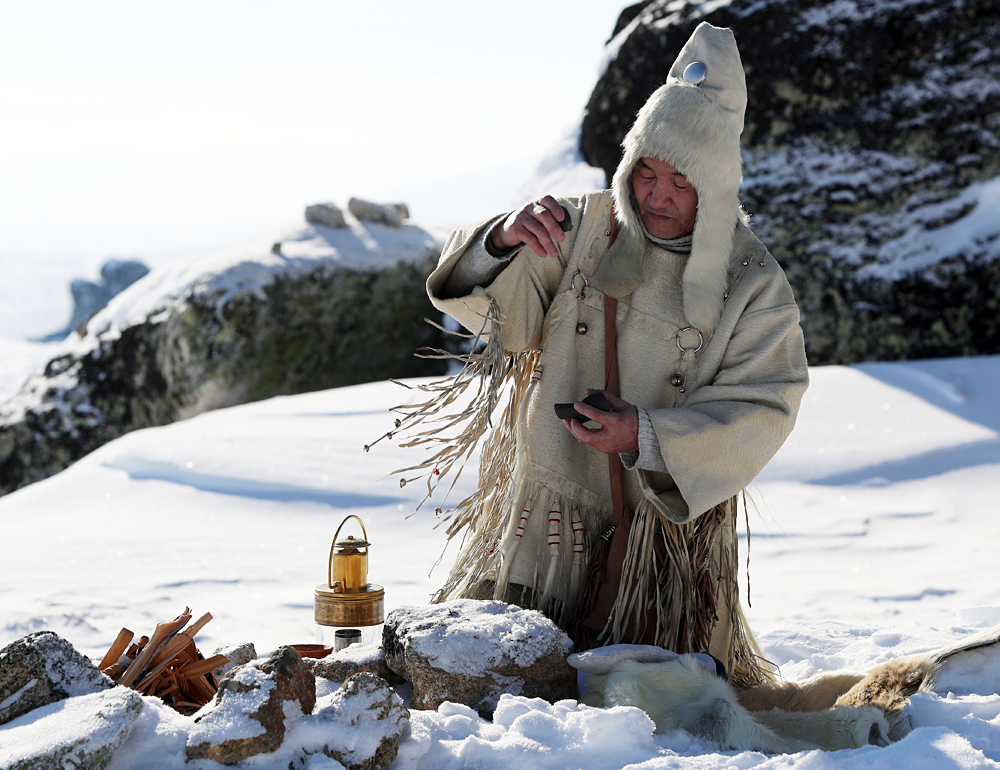 YAKUTIA, RUSSIA. MARCH 29, 2016. A shaman seen during a ceremony to light the 2016 Children of Asia International Sports Games torch on Mount Kisilyakh, a sacred place for the Yakuts. The relay covering more than 35,000 km (21,748 miles) will pass through 194 Yakut localities. The 6th Children of Asia International Sports Games will be held in the Sakha Republic (Yakutia) on July 6-17, 2016. 3,500 young athletes will take part in the competition.