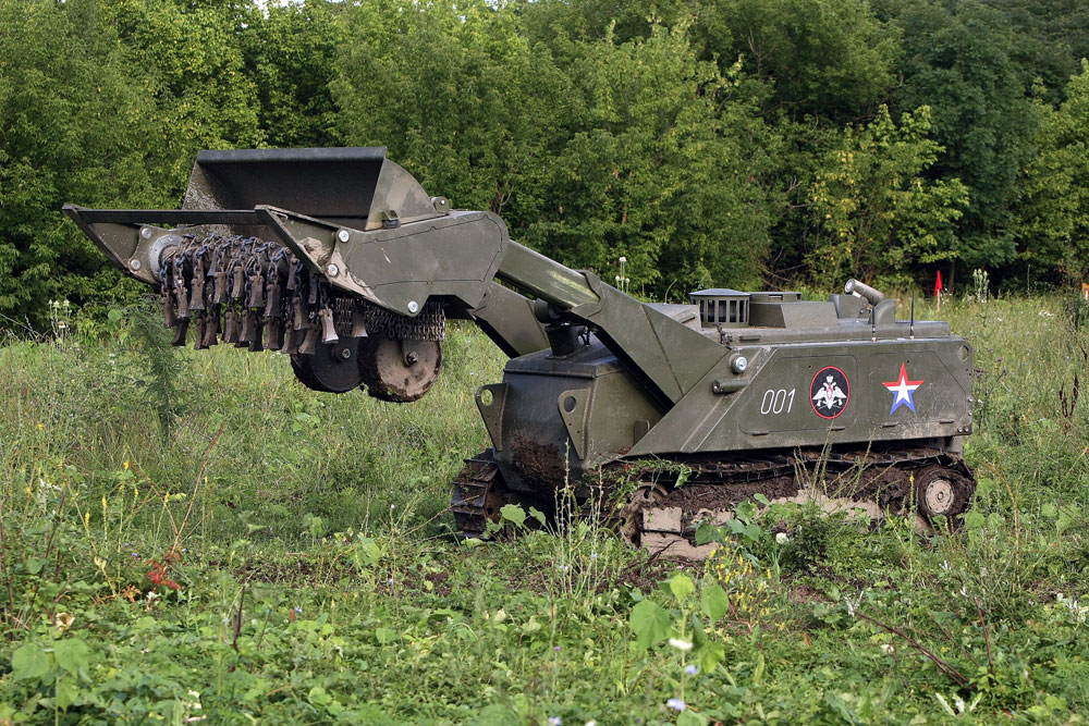 Testing the remote-controlled multirole Uran-6 robotic system, while defusing minefields in Chechnya's Sunzha District.