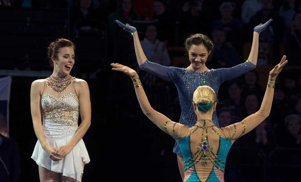 Gold medalist Evgenia Medvedeva of Russia (R, back) is greeted by bronze medalist Anna Pogorilaya of Russia (R, front) as silver medalist Ashley Wagner of the United States (L) looks on while on the podium during their victory celebration of the Ladies Skate portion of the 2016 ISU World Figure Skating Championships at the TD Garden in Boston, Massachusetts, USA, 02 April 2016. The Championship will be held from 30 March through 02 April 2016.
