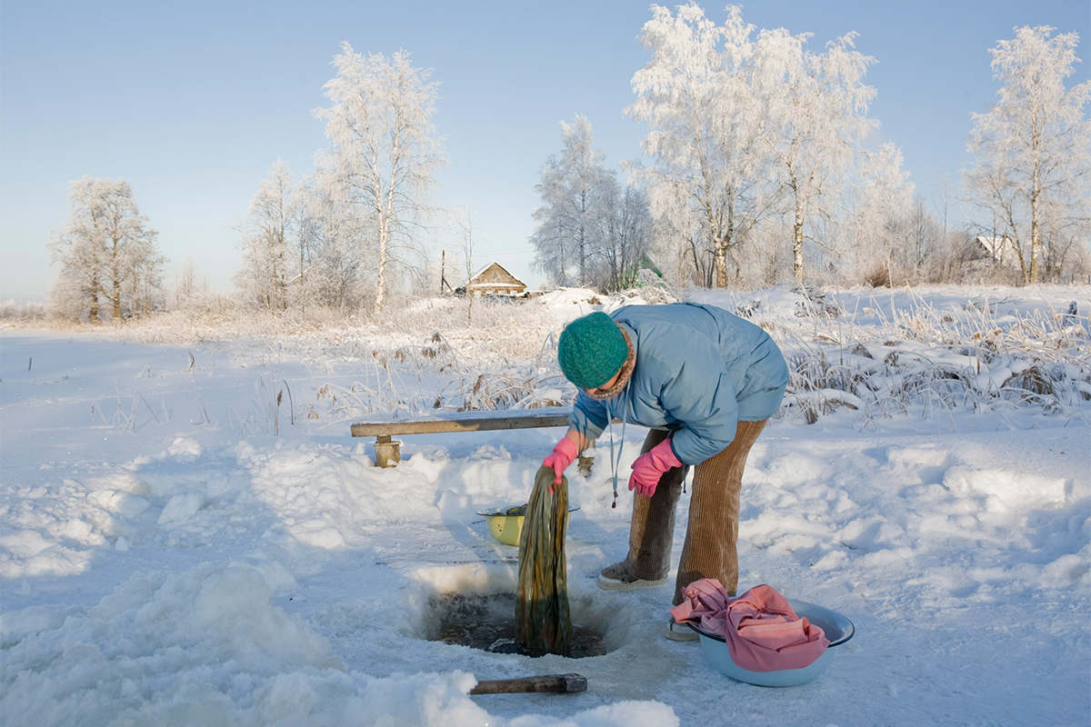 In winter inhabitants of the village make a hole in the ice and wash their linen in the icy water.