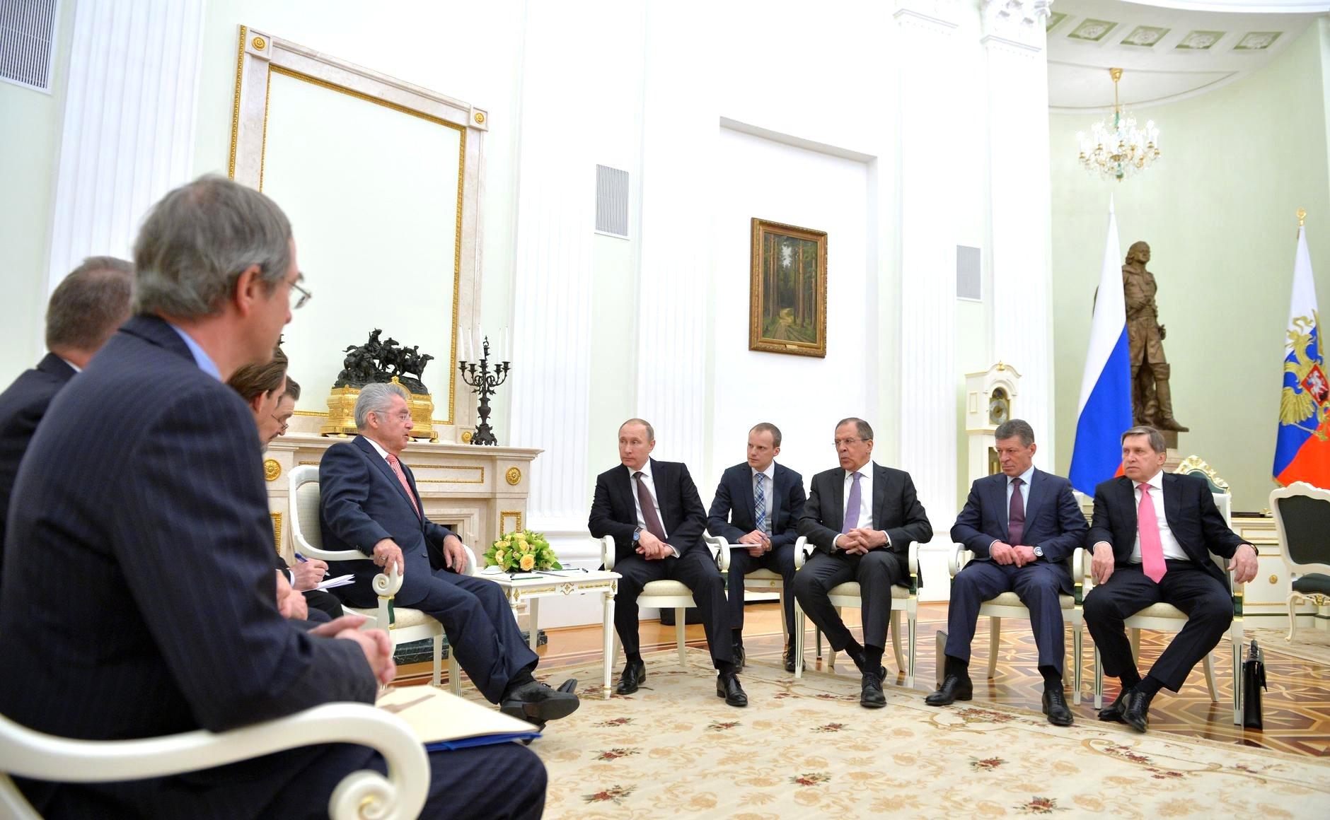 Russian President Vladimir Putin meets with Austrian President Heinz Fischer.