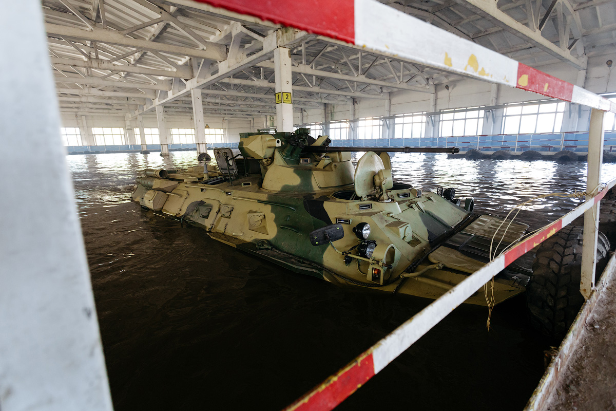 The pool is part of the testing process. The BTR maneuvers around pillars, and is then left submerged for a long time.