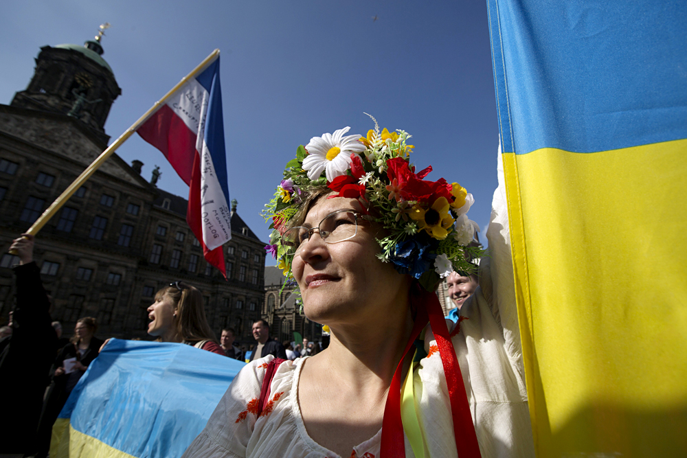 A Ukrainian woman stands in front of the Royal Palace during a demonstration on the EU referendum, at the Dam Square in Amsterdam.