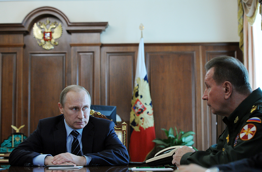 MOSCOW, RUSSIA. APRIL 5, 2016. Russia's President Vladimir Putin (L) and Russian Internal Troops commander Viktor Zolotov during a meeting at Moscow's Kremlin.