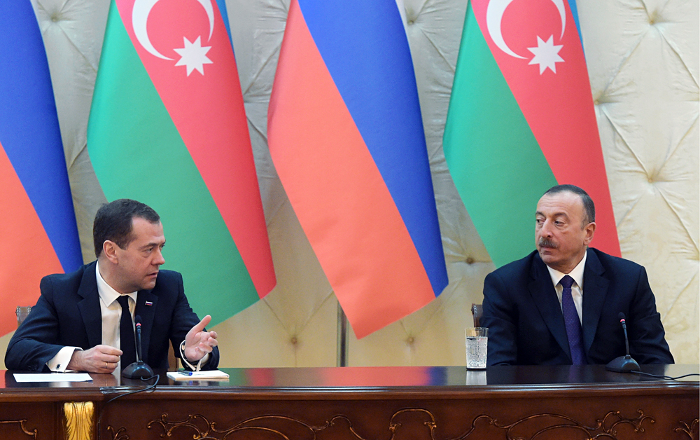 Russia's Prime Minister Dmitry Medvedev and Azerbaijan's President Ilham Aliyev give a joint press conference following their meeting, April 8.