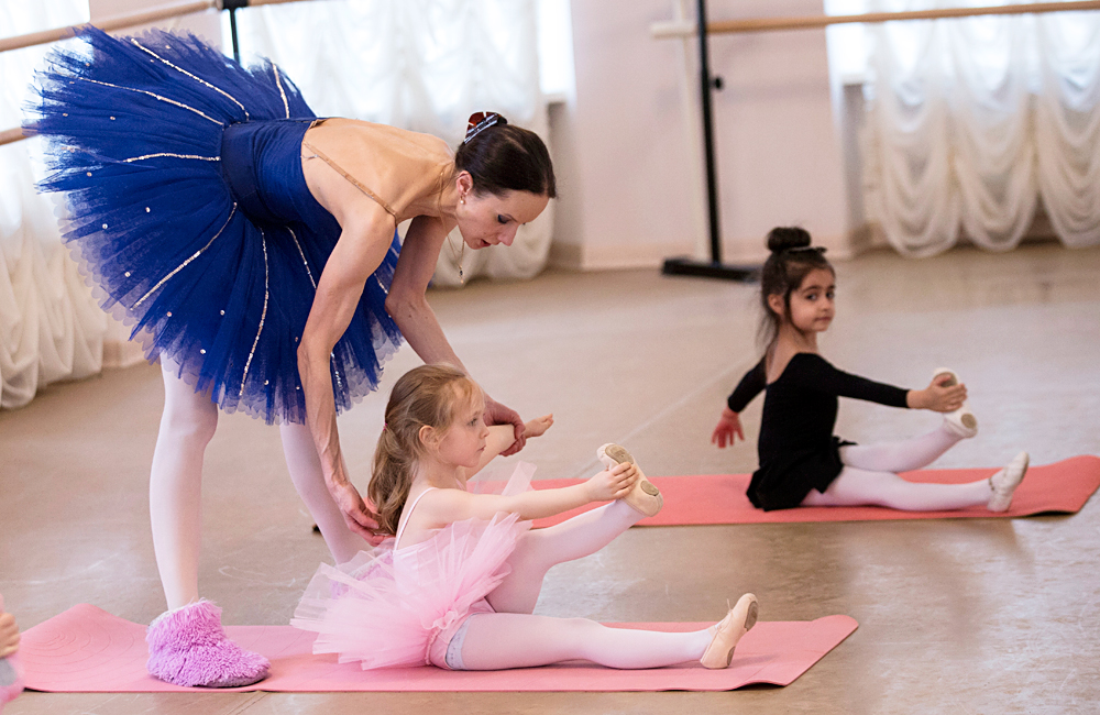 Kids attend a ballet class at the Balletomagia School.