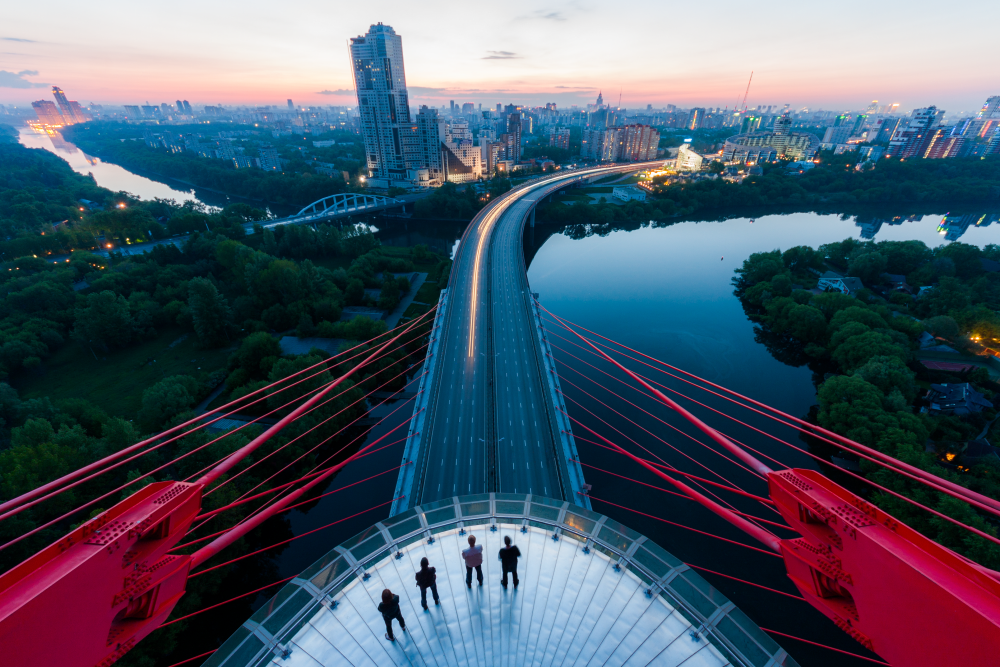 Vadim Makhorov and Vitaliyi Raskalov explore the world in a way that is unfathomable to most: they scale its tallest buildings, bridges and industrial structures without any safety equipment and take spectacular photographs to boot. / Zhivopisny Bridge, Moscow.