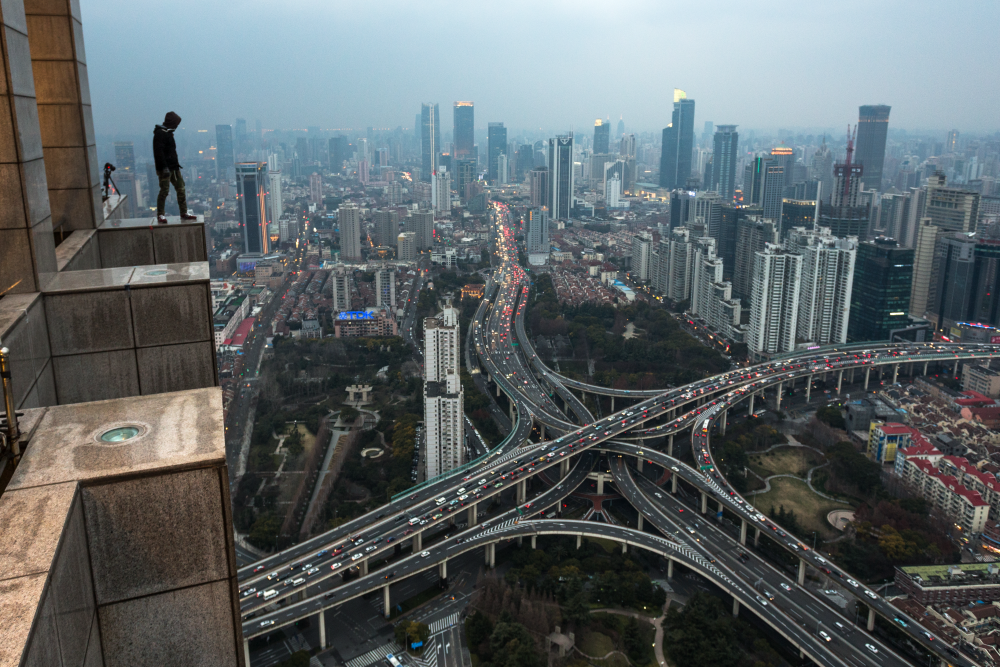 Their photos capture the stunning beauty of the world's most famous cities from unique angles. Their conquests include Moscow, St. Petersburg, Shanghai, Rio de Janeiro, New York and many other cities. / View on Shanghai.