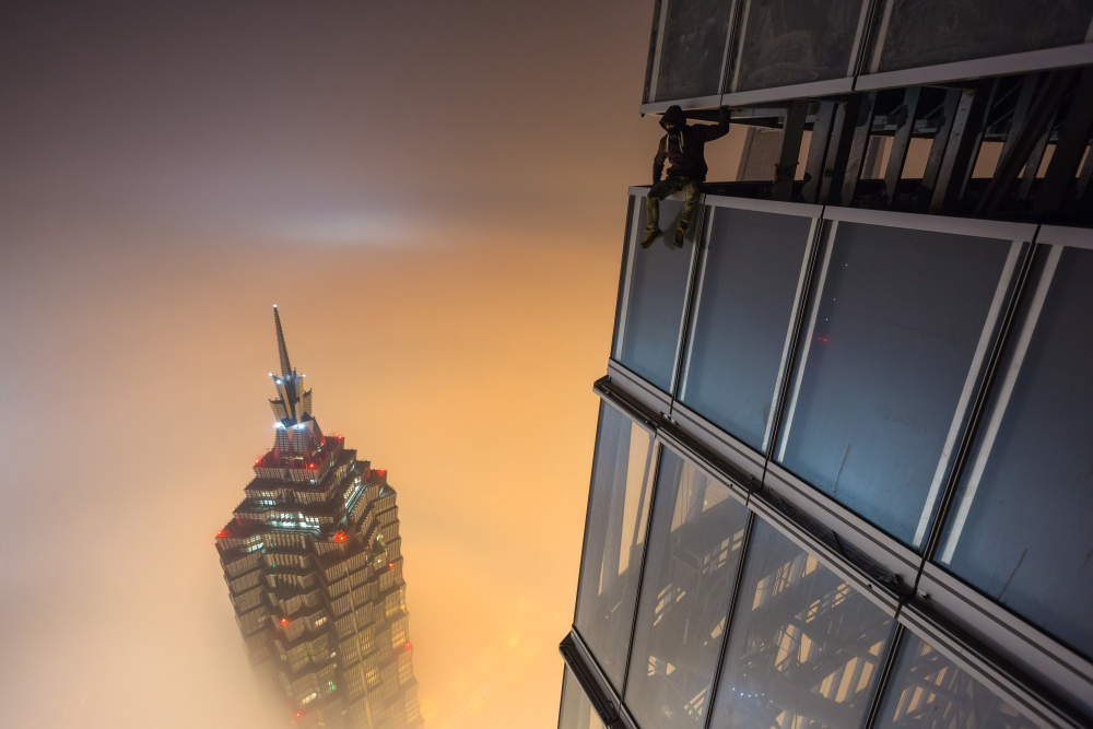 They achieved international fame after an adventure in Shanghai in 2014 when they climbed a Shanghai skyscraper (pictured). At a height of 650 meters (2,130 feet) they had to wait for 18 hours before the wind finally scattered the clouds and opened up a view of the city.