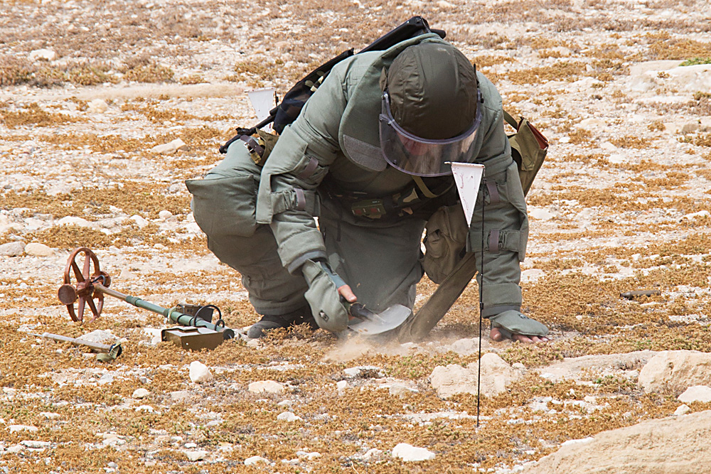 A Russian serviceman checks for mines in the Palmyra ancient ruins, Syria.