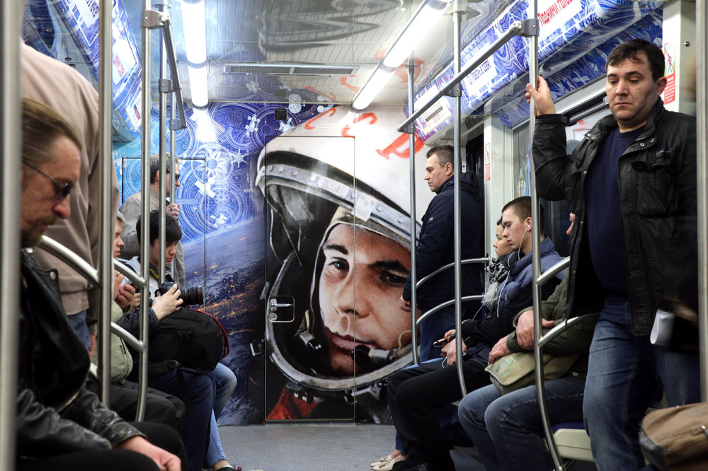 Commuters in a space themed train at Polezhayevskaya station of the Moscow Metro. The train was launched to mark the 55th anniversary of the first manned space flight by cosmonaut Yuri Gagarin. On April 12, 1961, Gagarin became the first man in space when he orbited the Earth aboard Vostok 1