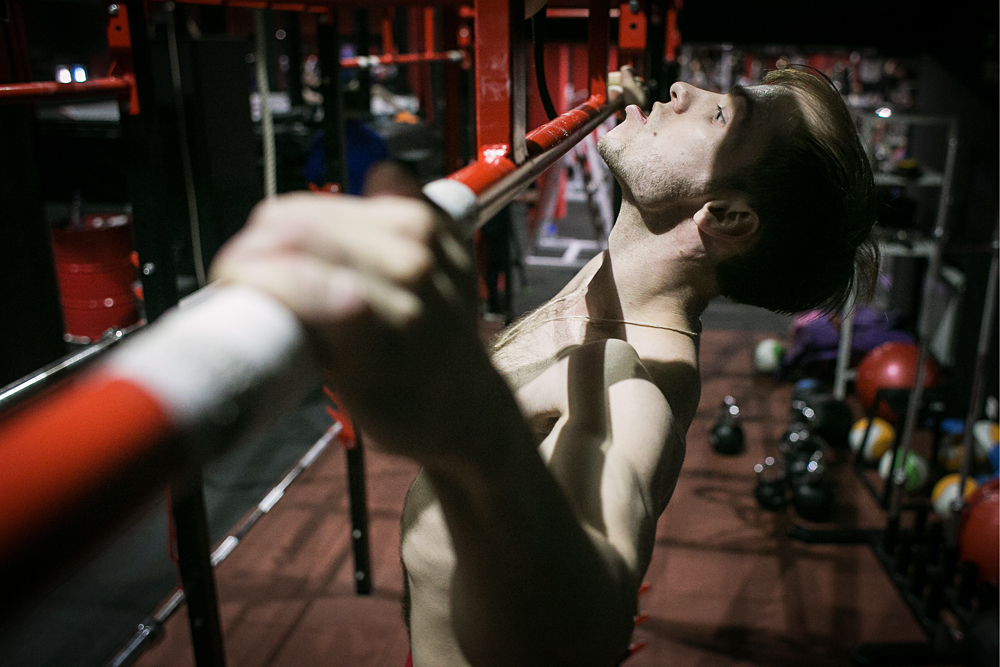 TOMSK, RUSSIA. APRIL 12, 2016. Russian athlete Viktor Filippov during a training session in a gym. Filippov has broken the pull-ups world record by doing 75 pull-ups in a minute. That beats the previous record by 16.