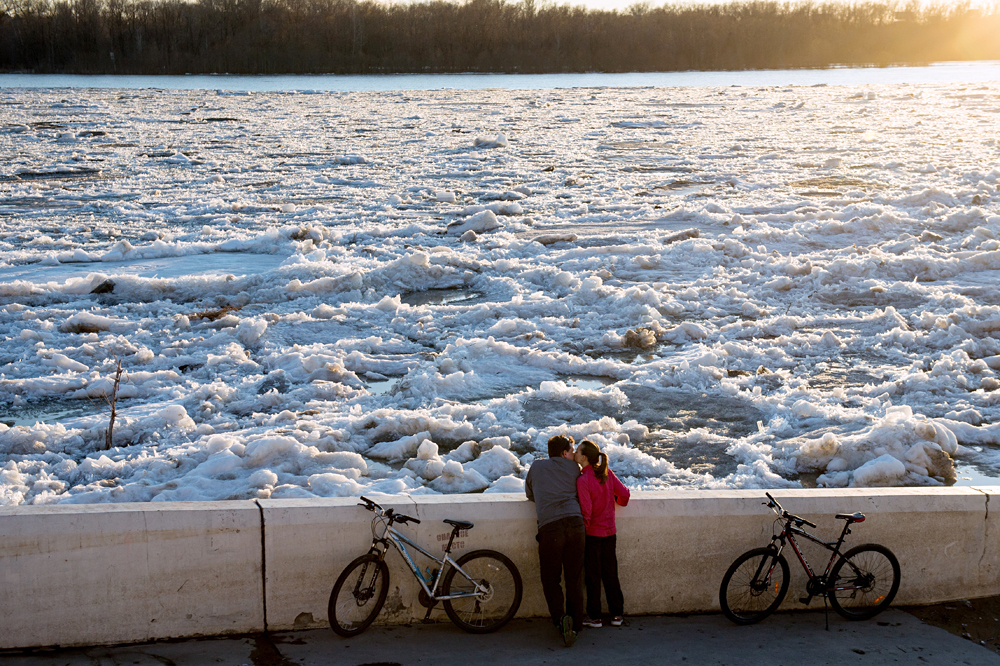 Ice breaks on Irtysh river in Omsk Region.  People walk along the Irtysh river in Omsk.