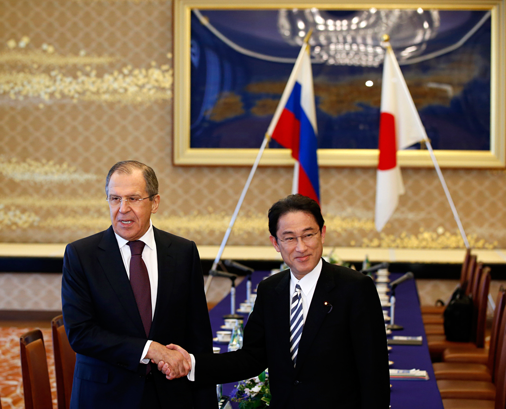 Russia's Foreign Minister Sergey Lavrov, left, and his Japanese counterpart Fumio Kishida shake hands during their meeting at the foreign ministry's Iikura guest house in Tokyo, Japan, Friday, April 15, 2016