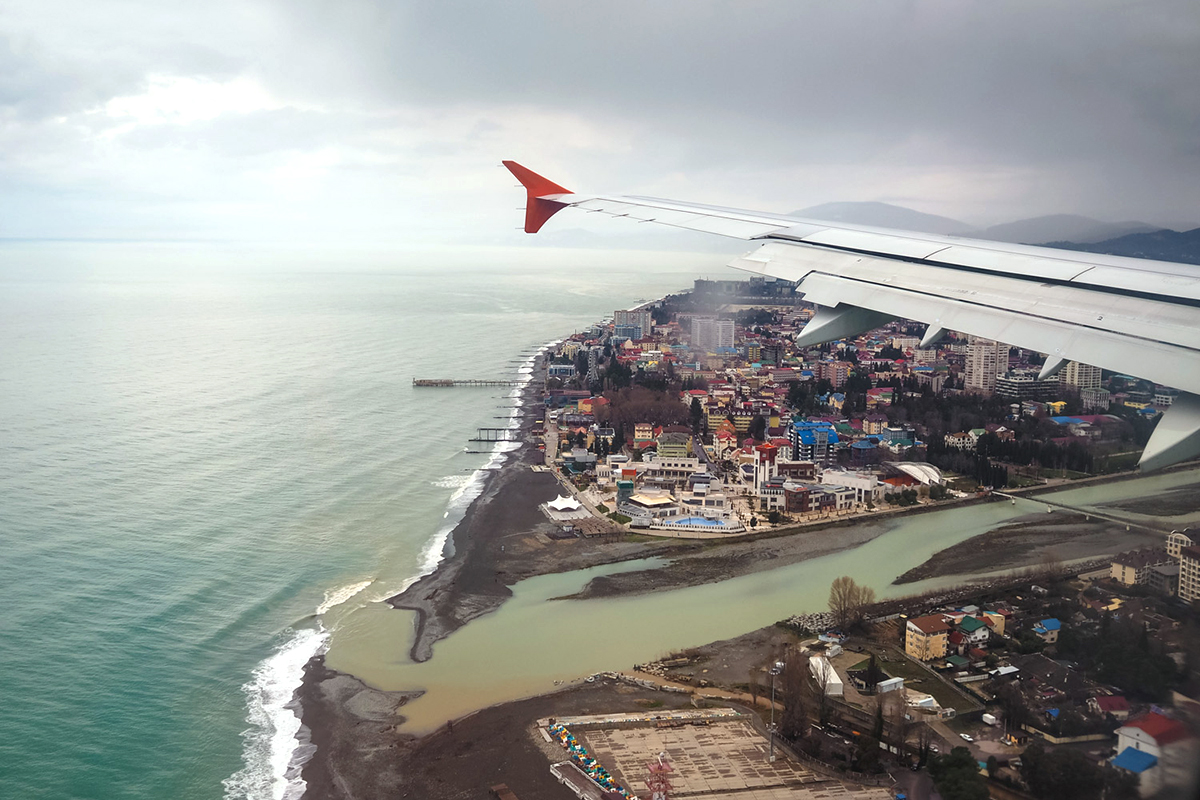 For many people the trip to Sochi begins with the same view. It takes three hours from Moscow to reach Sochi by plane. Sochi's new international airport now handles dozens of domestic and international flights daily. One may reach city center from the airport terminal (28 km) by bus, train, or taxi.