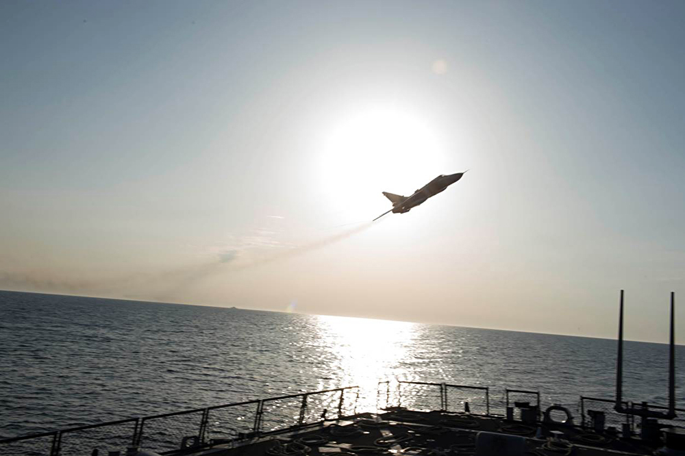 Russian Sukhoi Su-24 jet makes a low altitude pass by the USS Donald Cook in the Baltic Sea, April 12.
