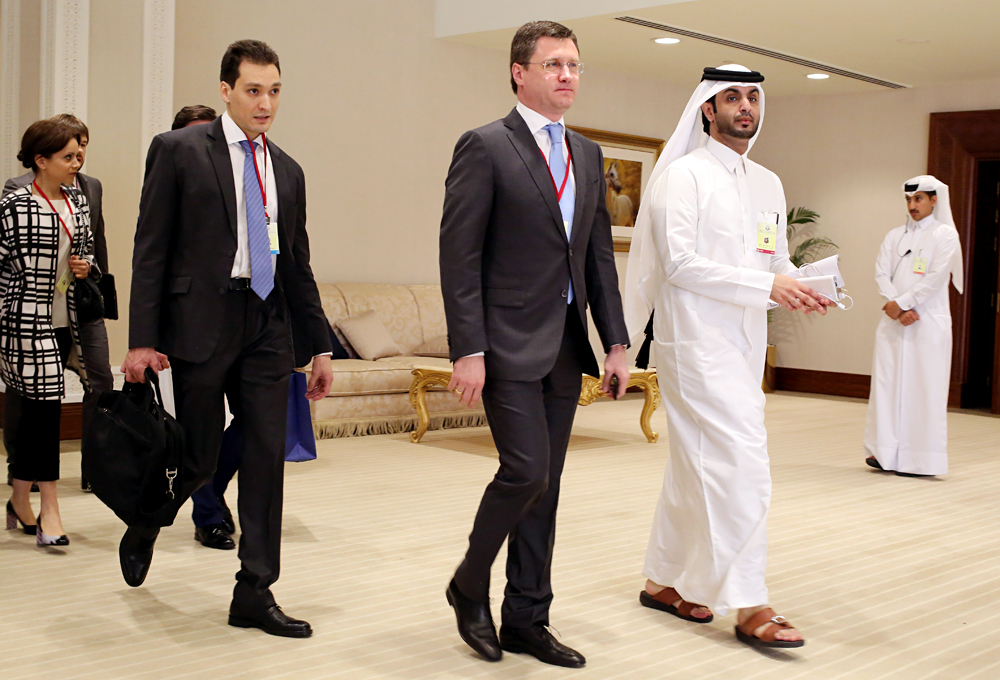 Russian Energy Minister Alexander Novak, center, arrives at an oil-producers' meeting in Doha, Qatar, on  April 17, 2016.