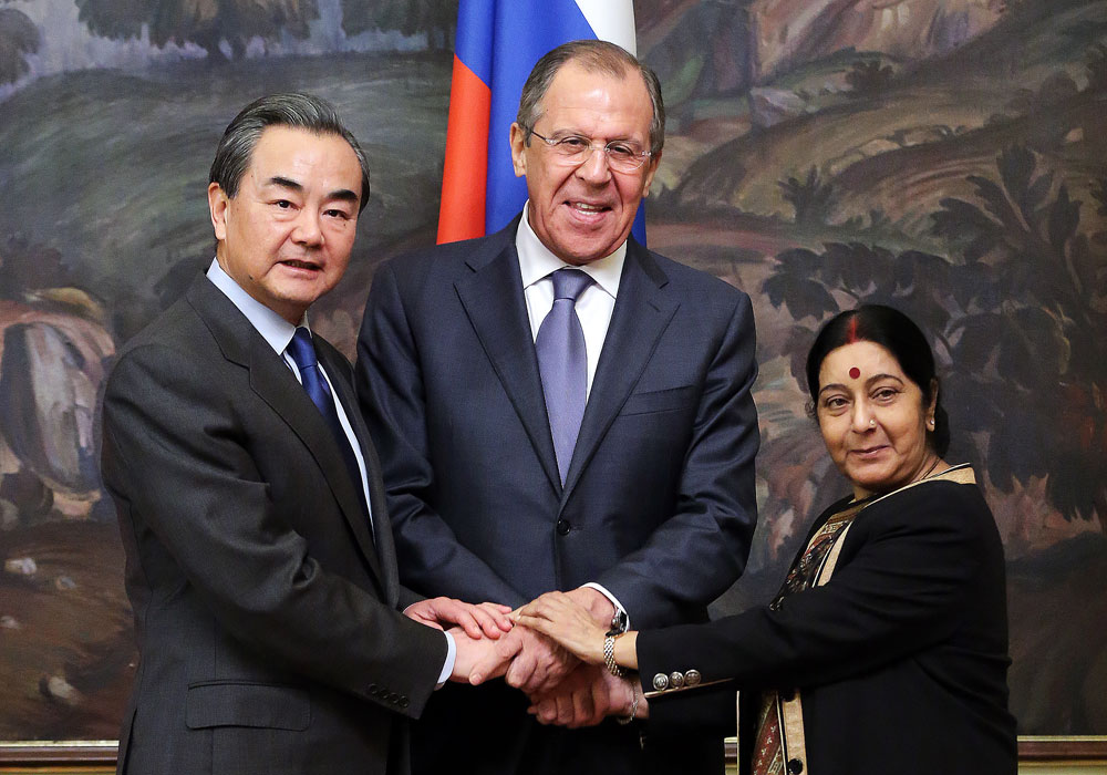China's Foreign Minister Wang Yi, Russia's Foreign Minister Sergei Lavrov, and India's Foreign Minister Sushma Swaraj (L-R) ahead of the 14th Russia-India-China (RIC) meeting of foreign ministers.