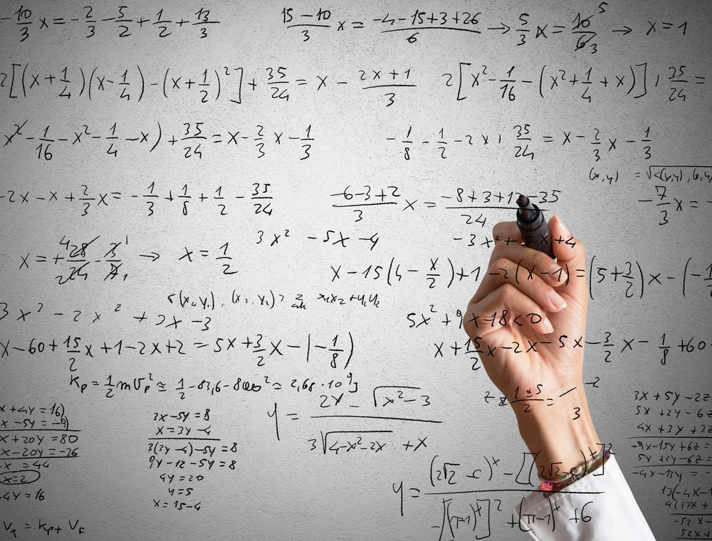 Woman explains and solves a mathematical calculation
