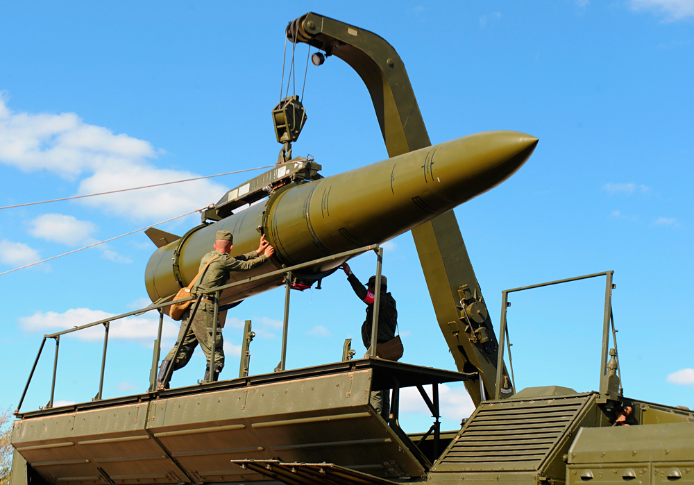 A rocket being loaded into an Iskander-M missile launcher.