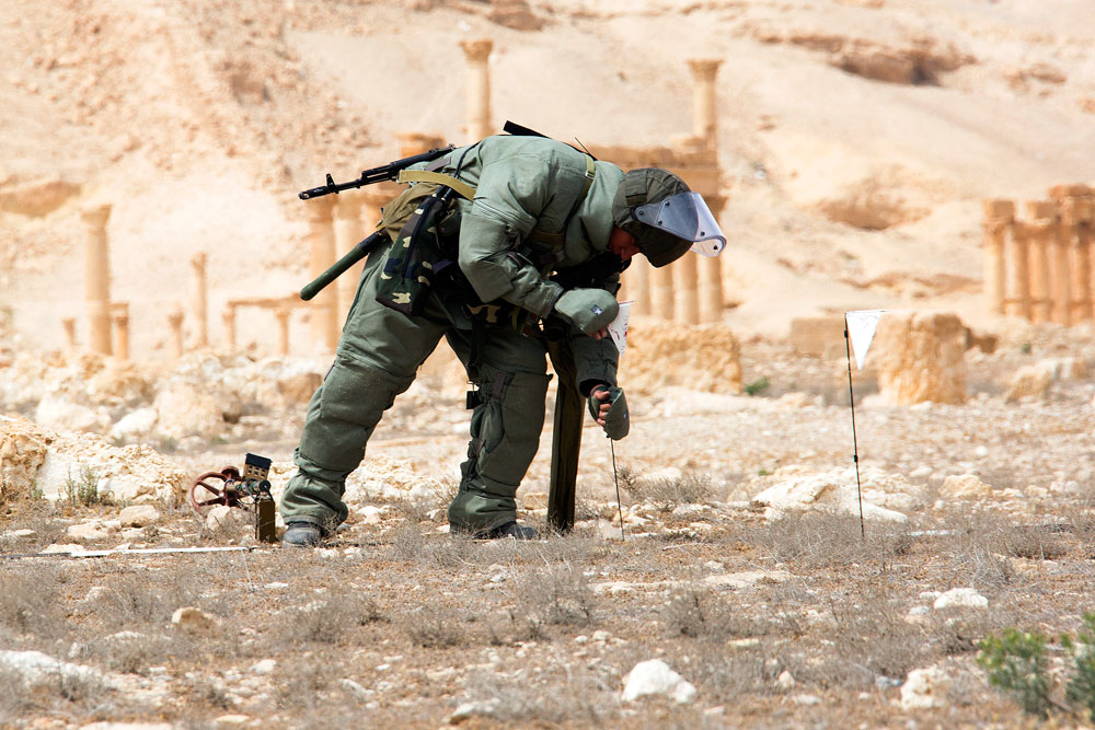 A combat engineer of the Russian Armed Forces' International Mine Action Center clearing mines from the ancient town of Palmyra. Islamic State militants have not only destroyed many of Palmyra's heritage sites but they have also laid mines in historic and residential parts of the town