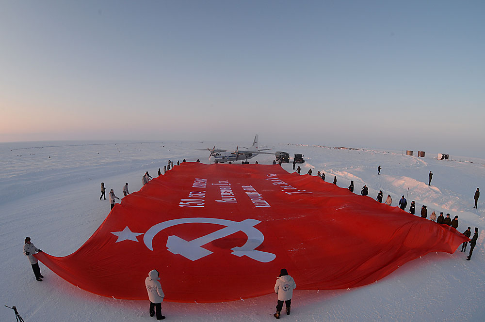 A delegation of the Largest Banner of Victory peace mission unveil a 1,056 square meter copy of the Banner of Victory on the North Pole ahead of celebrations of the 71st anniversary of the Great Victory.